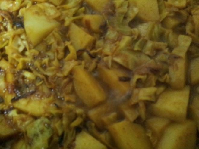 Add garam masala to Aloo Cabbage Sabzi