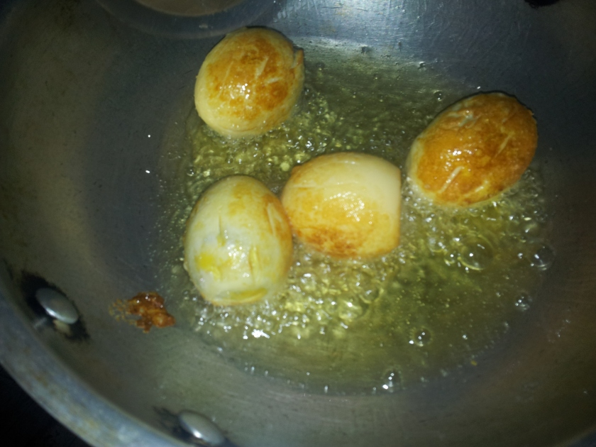 Frying the boiled eggs