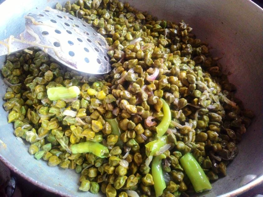 Preparing Hara Chana Ghugni