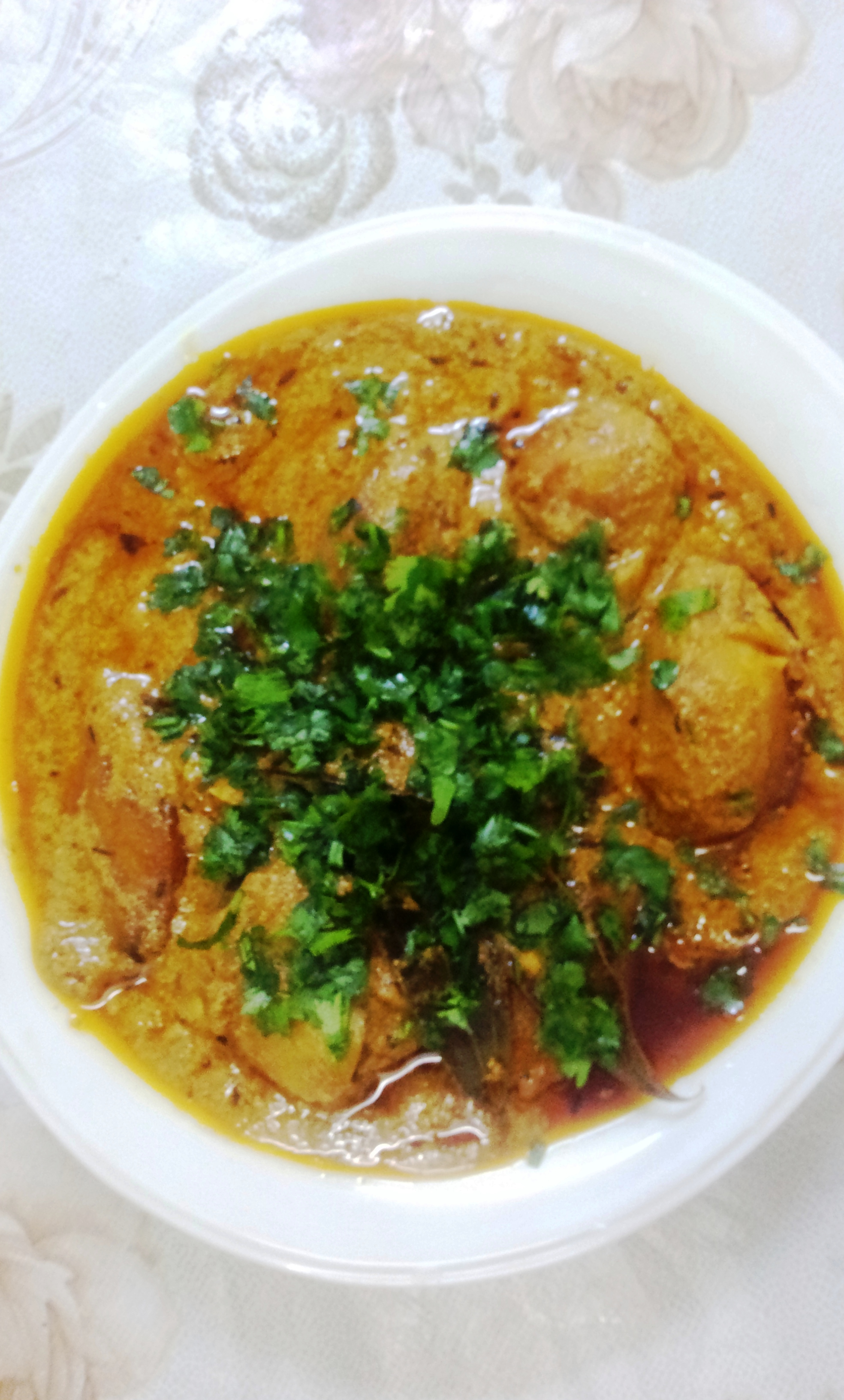 Kashmiri Dum Aloo is ready.. Garnish with dhaniya patta